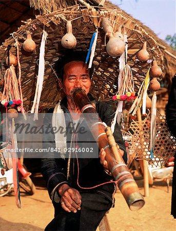 Smoker in Akha village, Golden Triangle pipe, Thailand, Southeast Asia, Asia