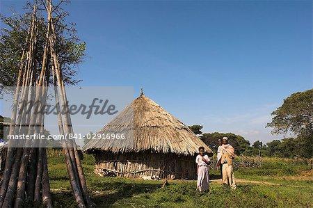 Oromo family outside their house, Oromo village near Langano lake, Rift Valley, Ethiopia, Africa