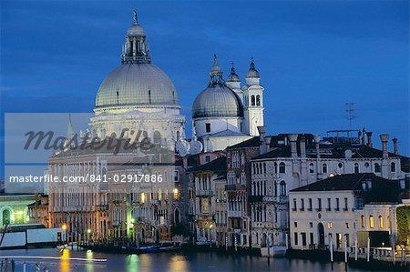 View along Grand Canal towards Santa Maria Della Salute church at night, Venice, UNESCO World Heritage Site, Veneto, Italy, Europe