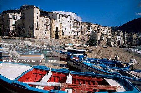Fishing harbour and Porta Pescara beyond, Cefalu, island of Sicily, Italy, Mediterranean, Europe
