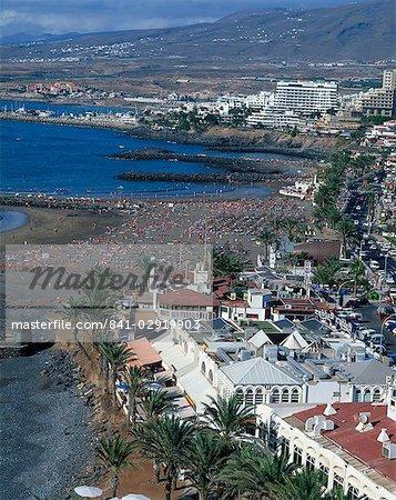 Tourists on the beach at Playa Troya, Puerto Colon, at the Playa de Las Americas, Los Cristianos, Tenerife, Canary Islands, Spain, Atlantic, Europe