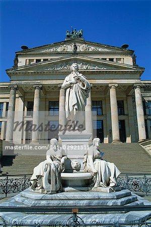 The Schiller monument and Schauspielhaus on the Gendarmenmarkt in Berlin, Germany, Europe