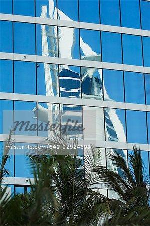 Burj Al Arab Hotel reflected in the Jumeirah Beach Hotel, Dubai, United Arab Emirates, Middle East