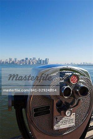 Coin operated binoculars, view of Manhattan skyline from Liberty Island, New York City, New York, United States of America, North America