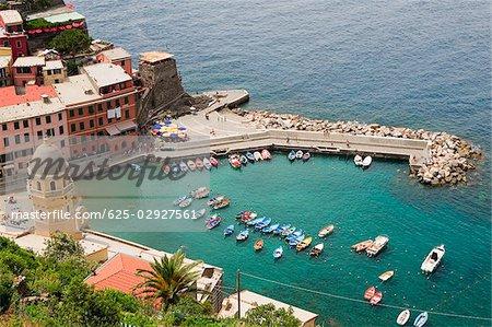 High angle view of boats in the sea, Church of Santa Margherita d'Antiochia, Doria Castle, Italian Riviera, Cinque Terre National Park, Vernazza, La Spezia, Liguria, Italy