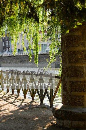 Wooden fence at the riverside, Sarthe River, Pont Yssoir, Le Mans, Sarthe, France