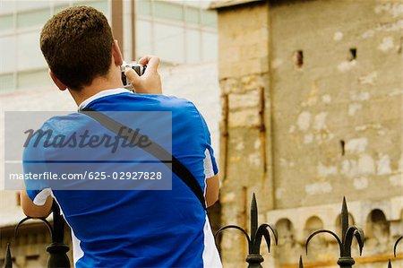 Man photographing a building, Ponte Monumentale, Genoa, Liguria, Italy
