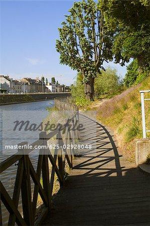 Wooden fence at the riverside, Sarthe River, Le Mans, Sarthe, France