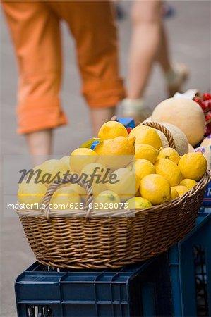 Close-up of lemons in a wicker basket at a market stall, Italian Riviera, Cinque Terre National Park, Vernazza, La Spezia, Liguria, Italy
