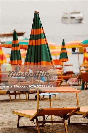Lounge chairs with beach umbrellas on the beach, Spiaggia Grande, Positano, Amalfi Coast, Salerno, Campania, Italy