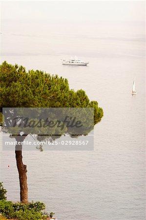 High angle view of a cruise ship and a sailboat in the sea, Positano, Amalfi Coast, Salerno, Campania, Italy