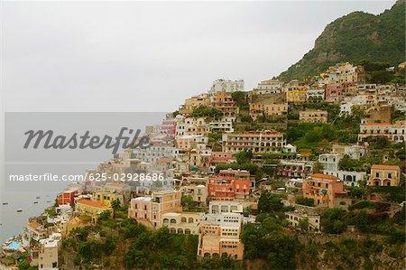 High angle view of town at the seaside, Positano, Amalfi Coast, Salerno, Campania, Italy