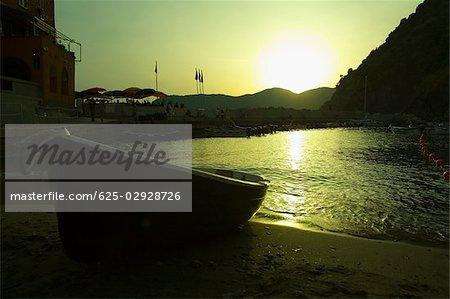 Boat on the beach at dusk, Italian Riviera, Cinque Terre National Park, Il Porticciolo, Vernazza, La Spezia, Liguria, Italy