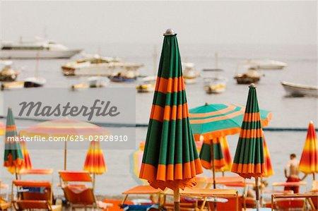 Beach umbrellas on the beach, Spiaggia Grande, Positano, Amalfi Coast, Salerno, Campania, Italy