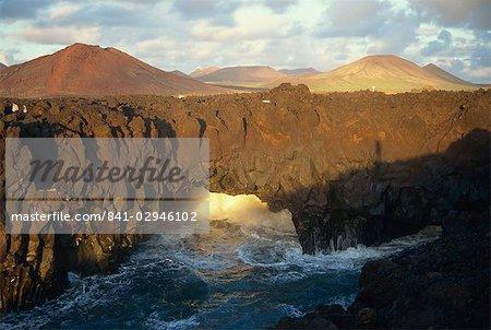 Crashing waves meet the lava fields, El Golfo, Lanzarote, Canary Islands, Spain, Atlantic, Europe