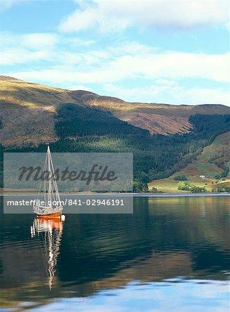Wooden yacht on Loch Leven, in autumn, Glencoe, Highland region, Scotland, United Kingdom, Europe
