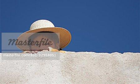 Amaryan girl peeking from behind wall,The Island of The Sun,Lake Titicaca,Bolivia