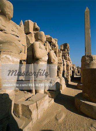 Pharaoh statues holding key of life,Karnak Temple,Precinct of Amun,Luxor,Egypt