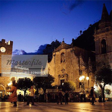 Piazza IX Aprile,Torre del'Orologio and San Giuseppe church at night,Taormina,Sicily,Italy.