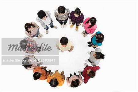 Man in circle of people