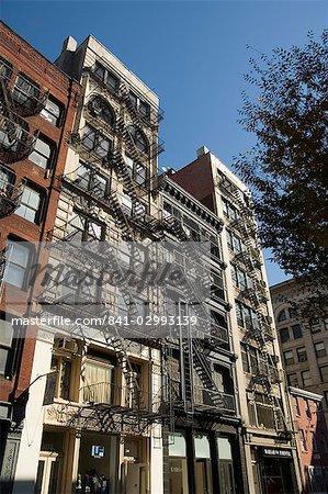Escaliers de secours à l'extérieur des bâtiments Spring Street, Soho, Manhattan, New York City, New York, États-Unis d'Amérique, Amérique du Nord