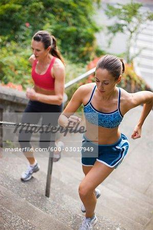 Women Running up Steps, Seattle, Washington, USA
