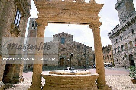 Duomo through wellhead, Montepulciano, Tuscany, Italy, Europe