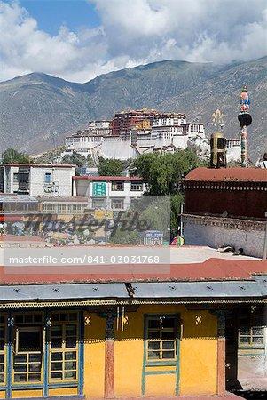 View of Potala Palace, the Dalai Lama's former palace, from Jokhang Temple, Lhasa, Tibet, China, Asia