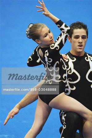 Teenager gymnasts performing arts together