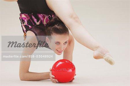 Rhythmic gymnastics,girl doing routine with ball