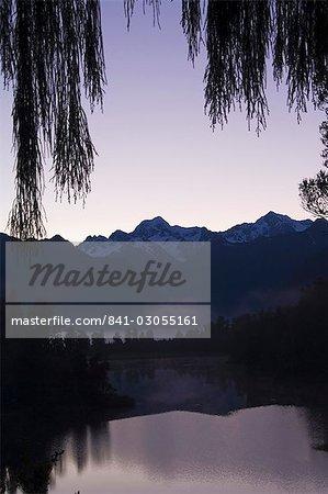 Lake Matheson at dawn, with Mount Tasman and Aoraki (Mount Cook), 3754m, Australasia's highest mountain, Southern Alps, South Island New Zealand, Pacific
