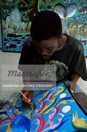 Zanzibari artist painting Tingatinga painting, Stone Town, Zanzibar, Tanzania, East Africa, Africa
