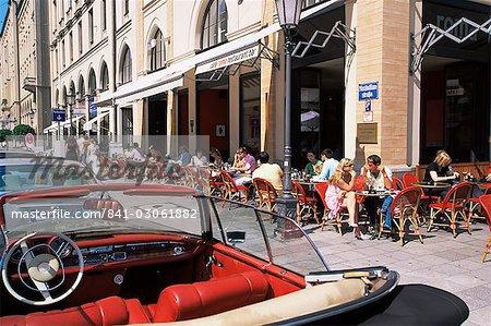 People sitting outside Cafe Roma on Maximilianstrasse, Munich, Bavaria, Germany, Europe