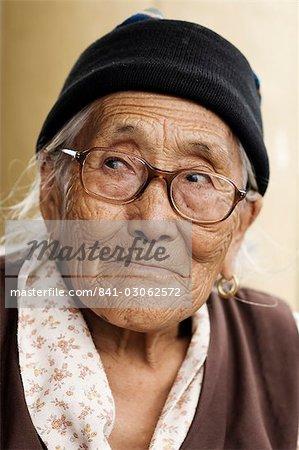 Portrait of a Tibetan woman, McLeod Ganj, Dharamsala, Himachal Pradesh state, India, Asia
