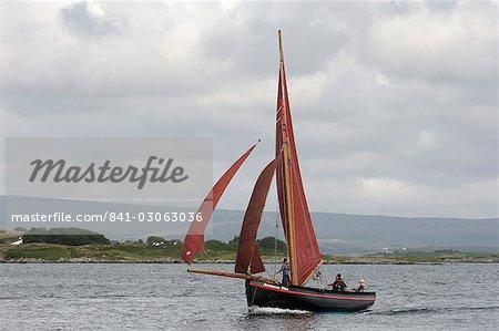 Galway hookers at Roundstone Regatta, Connemara, County Galway, Connacht, Republic of Ireland, Europe