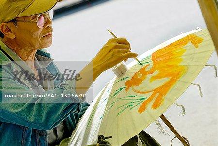 Man decorating umbrella, Borsang, Chiang Mai, Thailand, Southeast Asia, Asia