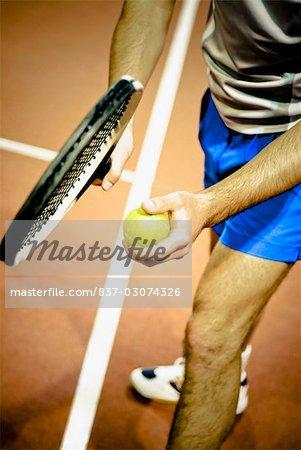 Jouer au tennis dans une Cour de tennis