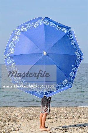 Boy with Umbrella at Beach