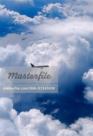 BOEING 767 FLYING THROUGH CLOUDS OVER NORTH ATLANTIC OCEAN
