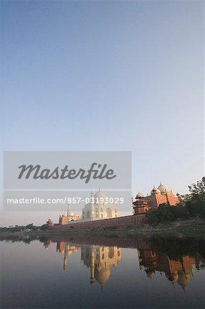 Reflection of a mausoleum in a river, Taj Mahal, Yamuna River, Agra, Uttar Pradesh, India