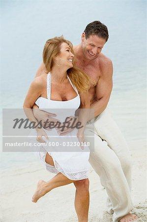 Couple Running on Beach, Mount Dora, Lake County, Greater Orlando, Florida, USA