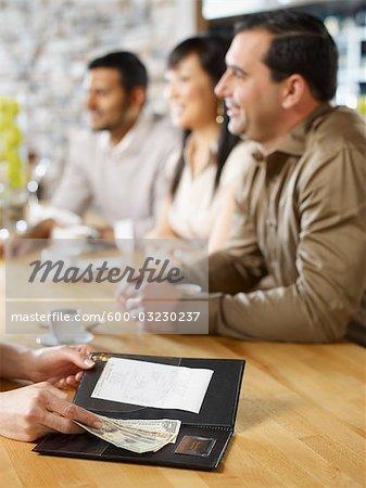 Friends Paying Bill at Wine Bar, Toronto, Ontario, Canada