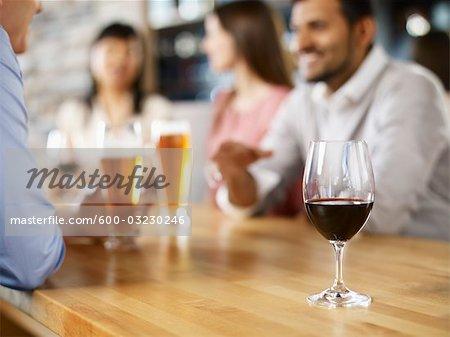 Friends Having Drinks at Wine Bar, Toronto, Ontario, Canada