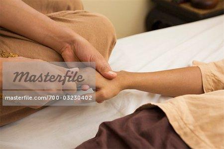 Femme assure un Massage Thai, Bangkok, Thaïlande