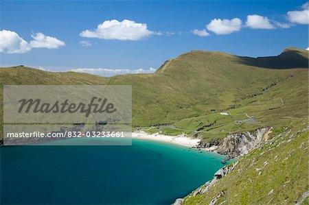 Achill Island, Co Mayo, Ireland; Keem Strand surrounded by lush hills
