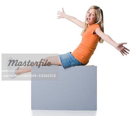 Girl sitting on blank sign
