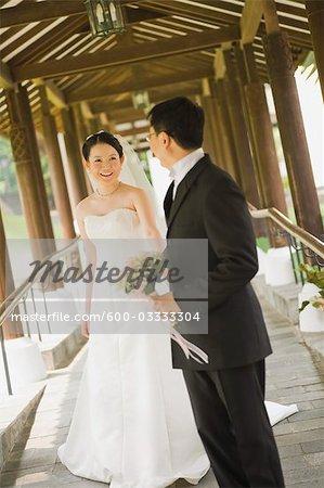 Newlywed Couple on Covered Bridge