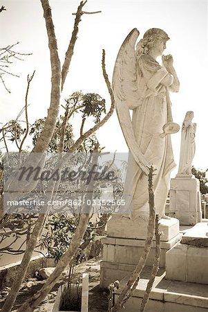 Cuba,Cienfuegos. Details of memorials and graves at a cemetery,Cienfuegos