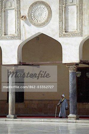 An old Egyptian man walks through the Al Azhar mosque in Cairo.