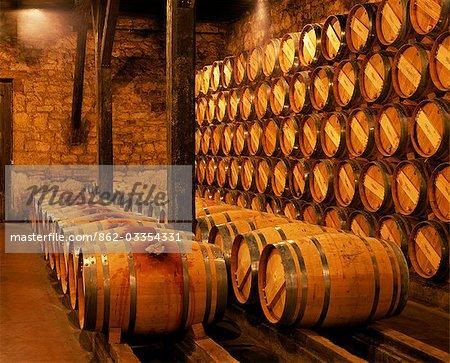 Barrels of Rioja wine in the underground cellars at Muga winery